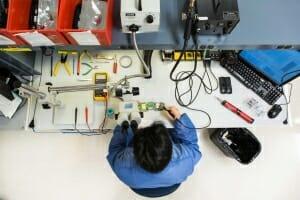 Repair technician repairing a barcode scanner